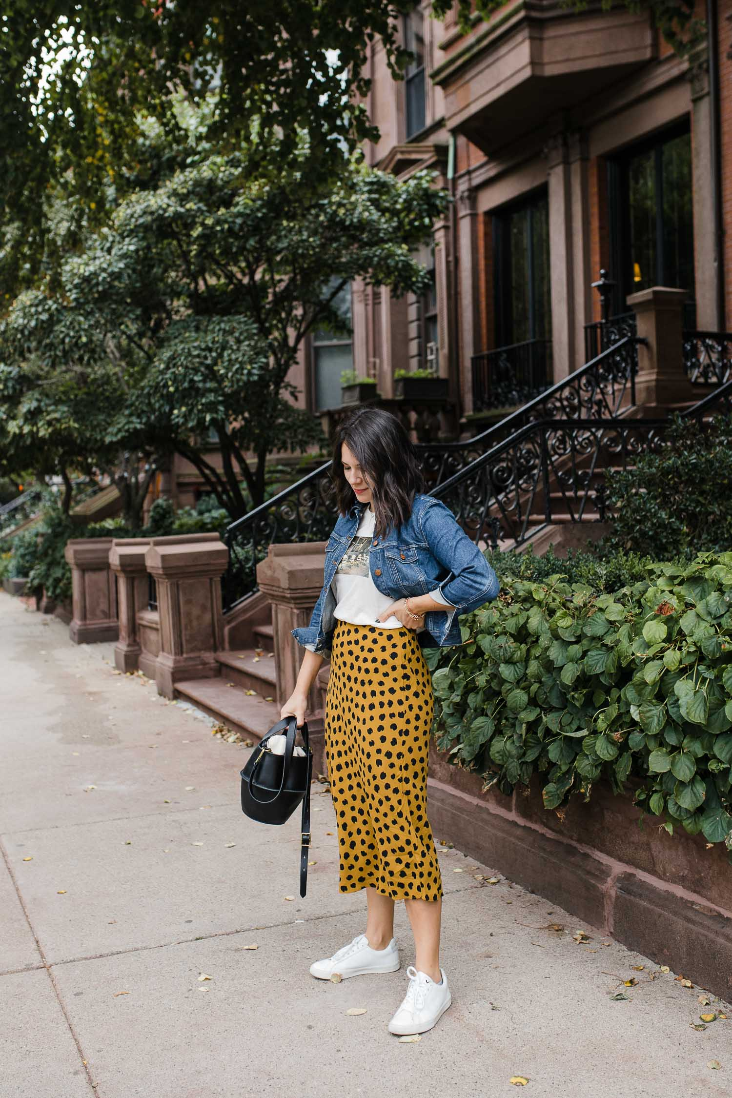 a girl in a spotted skirt and a jean jacket