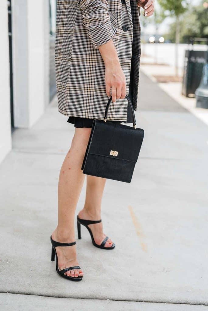 a blazer and a black purse