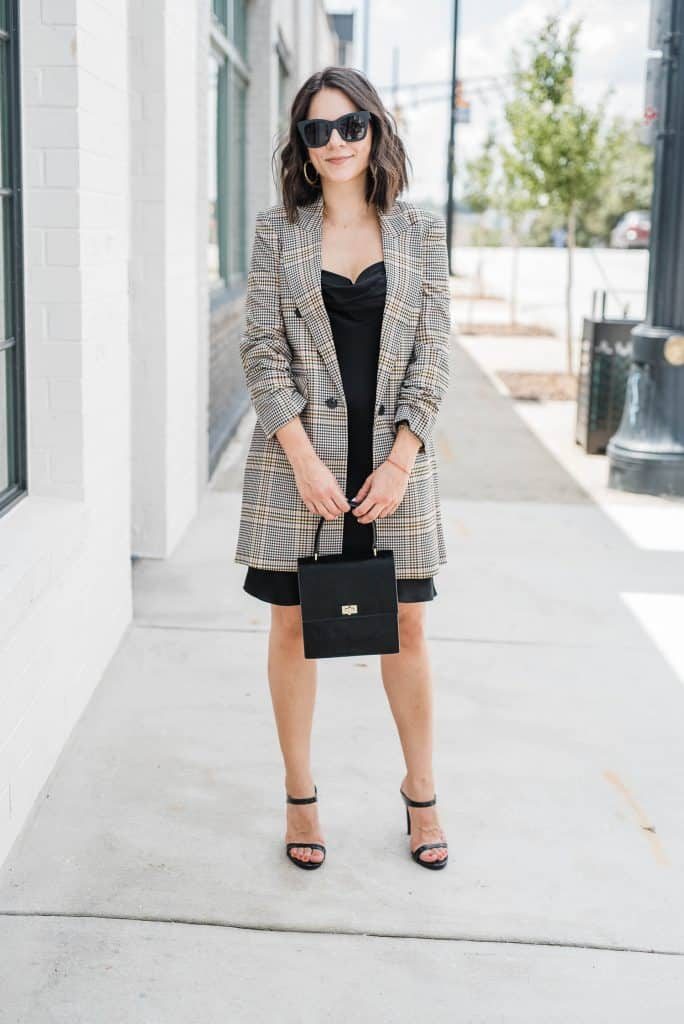 a woman demonstrating How To Wear Plaid Blazers