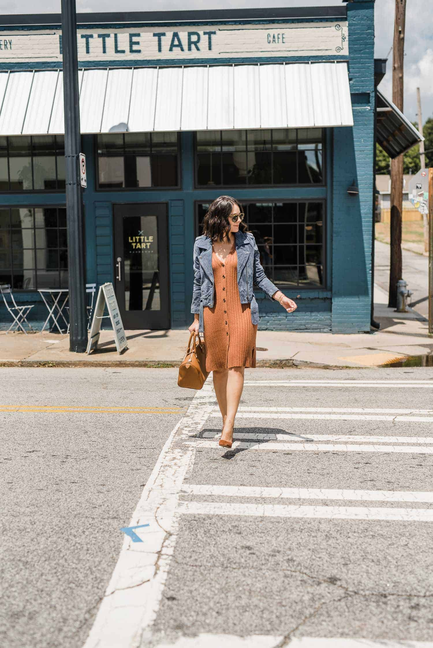 what to buy includes a beige dress, a jean jacket, and a tan bag