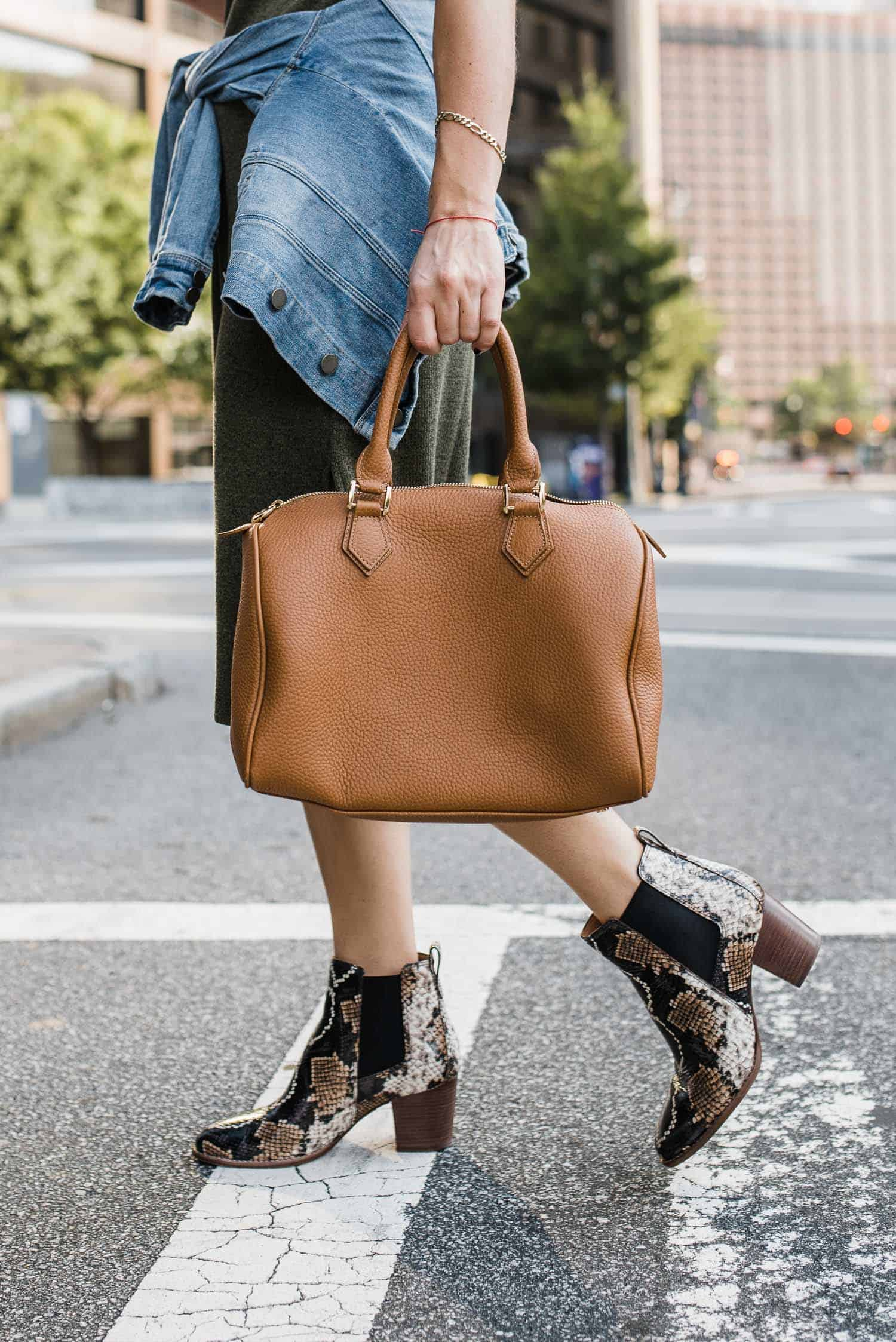 brown bag and snakeskin ankle boots