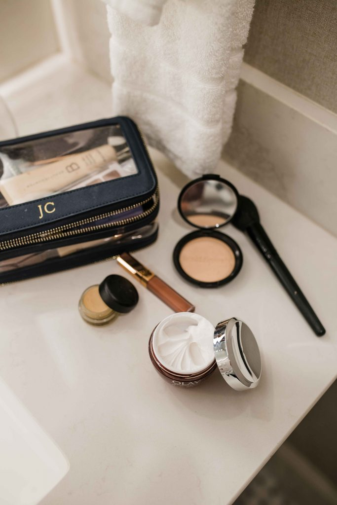 a makeup set and skincare product olay on a counter