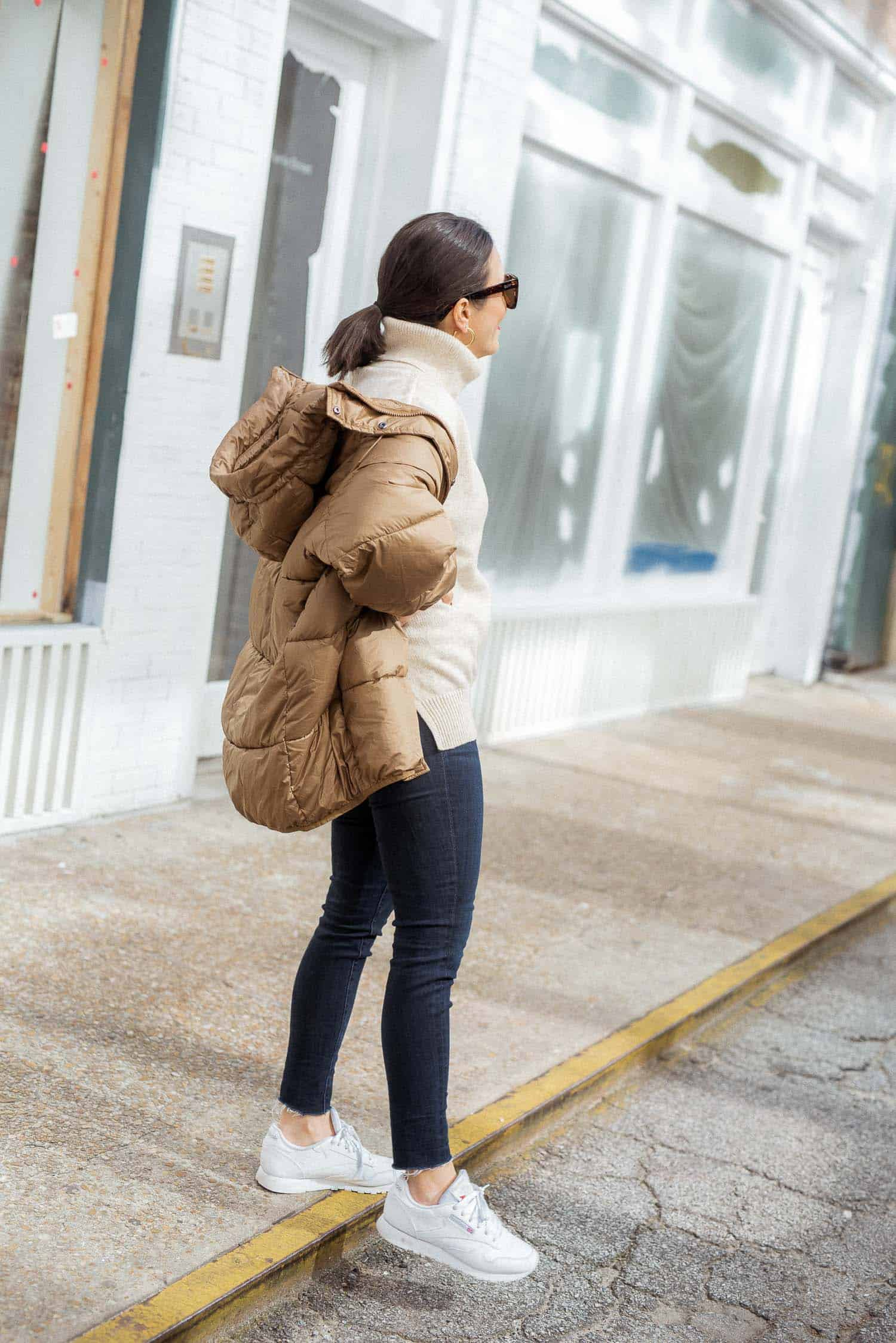 Jessica of My Style Vita wearing a puffy coat and Reeboks.