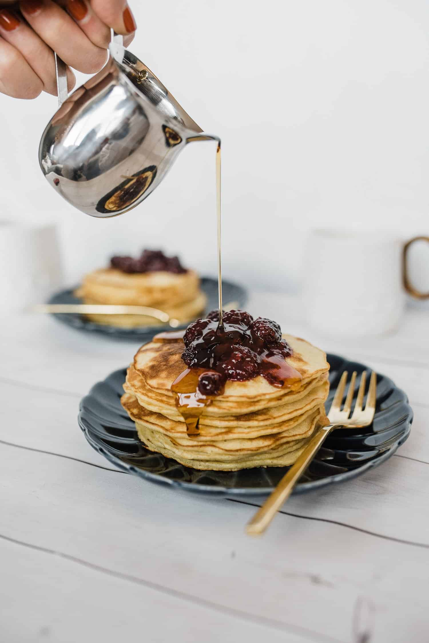 For a fresh take on pancakes, try swapping your regular dairy for oatmilk. It's a more flavorful alternative that creates delicious pancakes for breakfast or brunch! Top with the easiest berry sauce ever! #recipe #pancakes #brunch