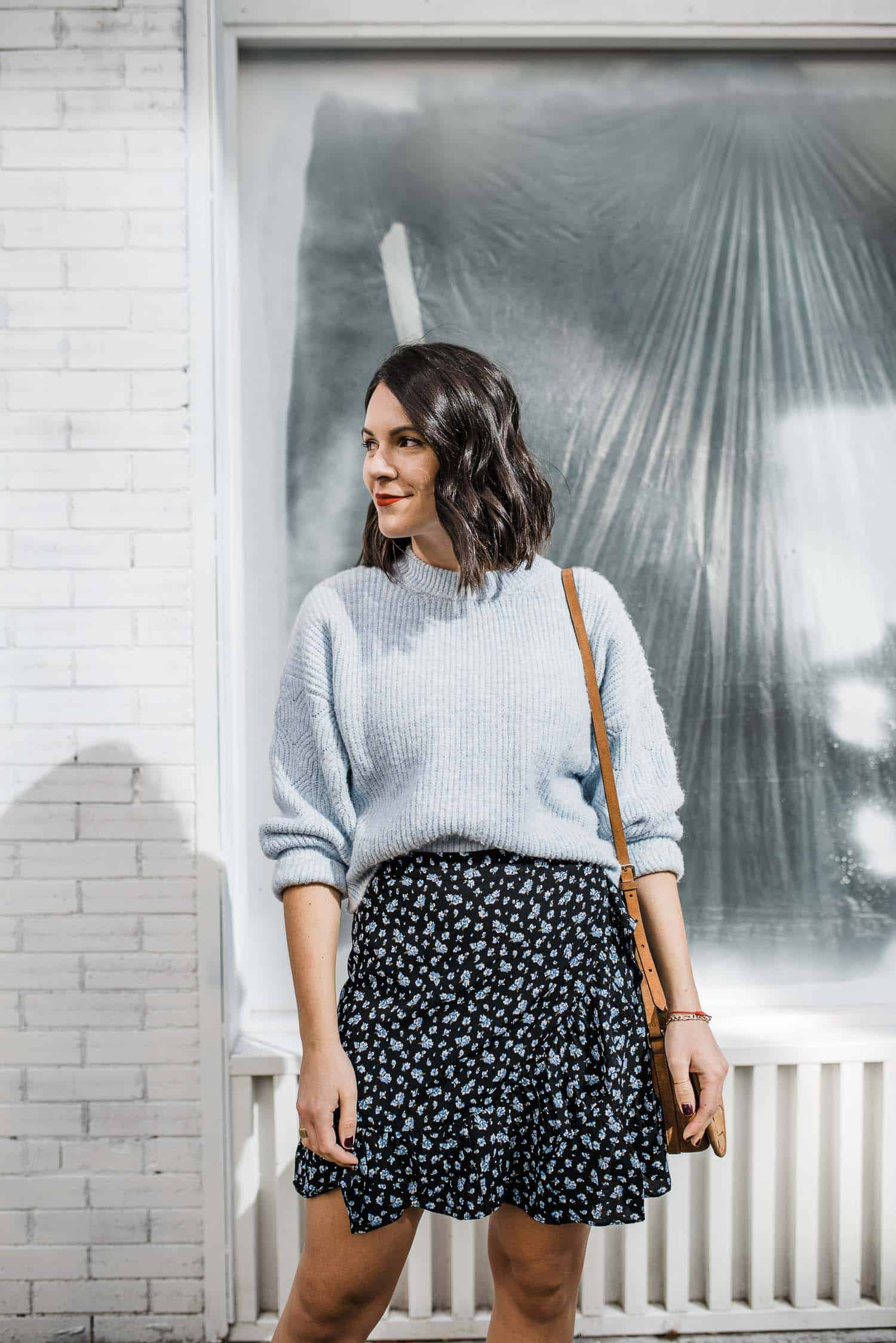 floral mini skirt and blue sweater