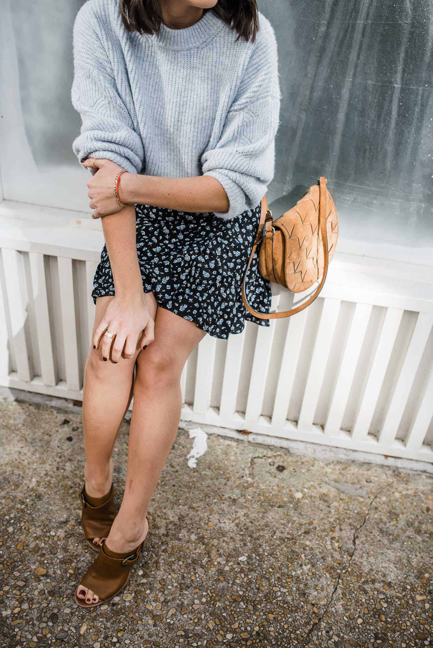 floral mini skirt and blue sweater outfit details