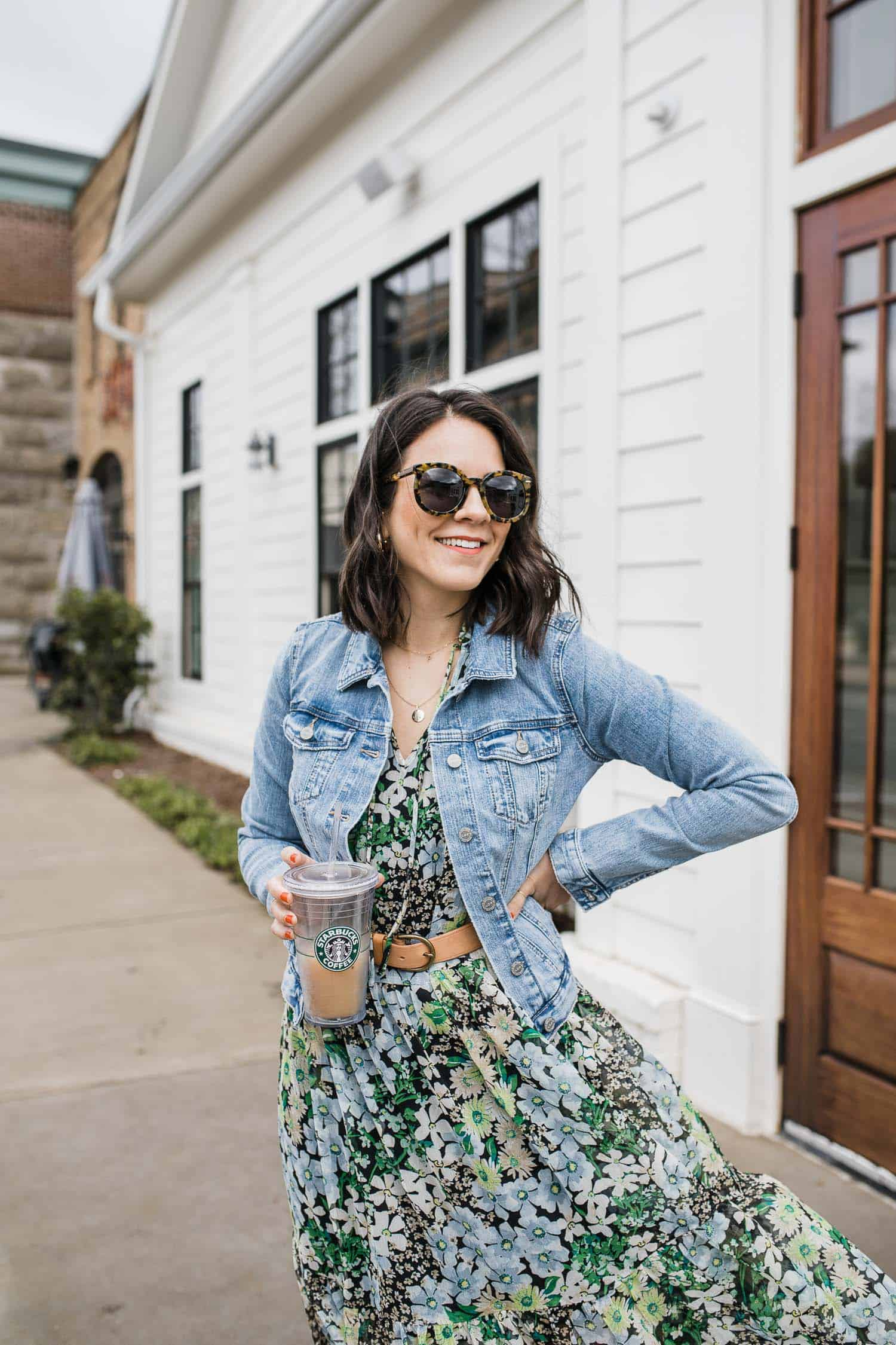 jessica camerata wears a denim jacket with a floral dress