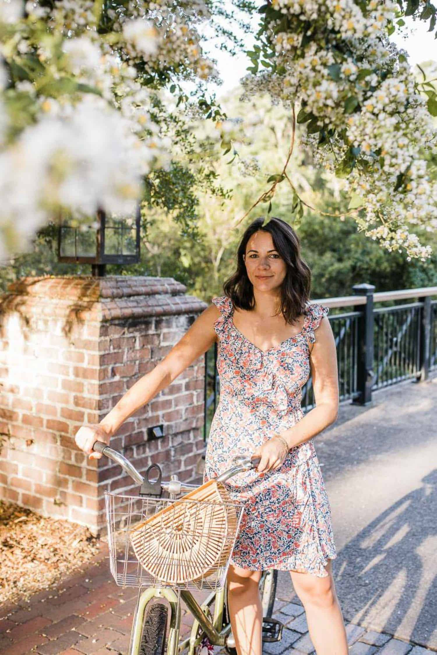 Jessica Camerata's outfit details: 1 State Floral Mini Dress, Cult Gaia Bag