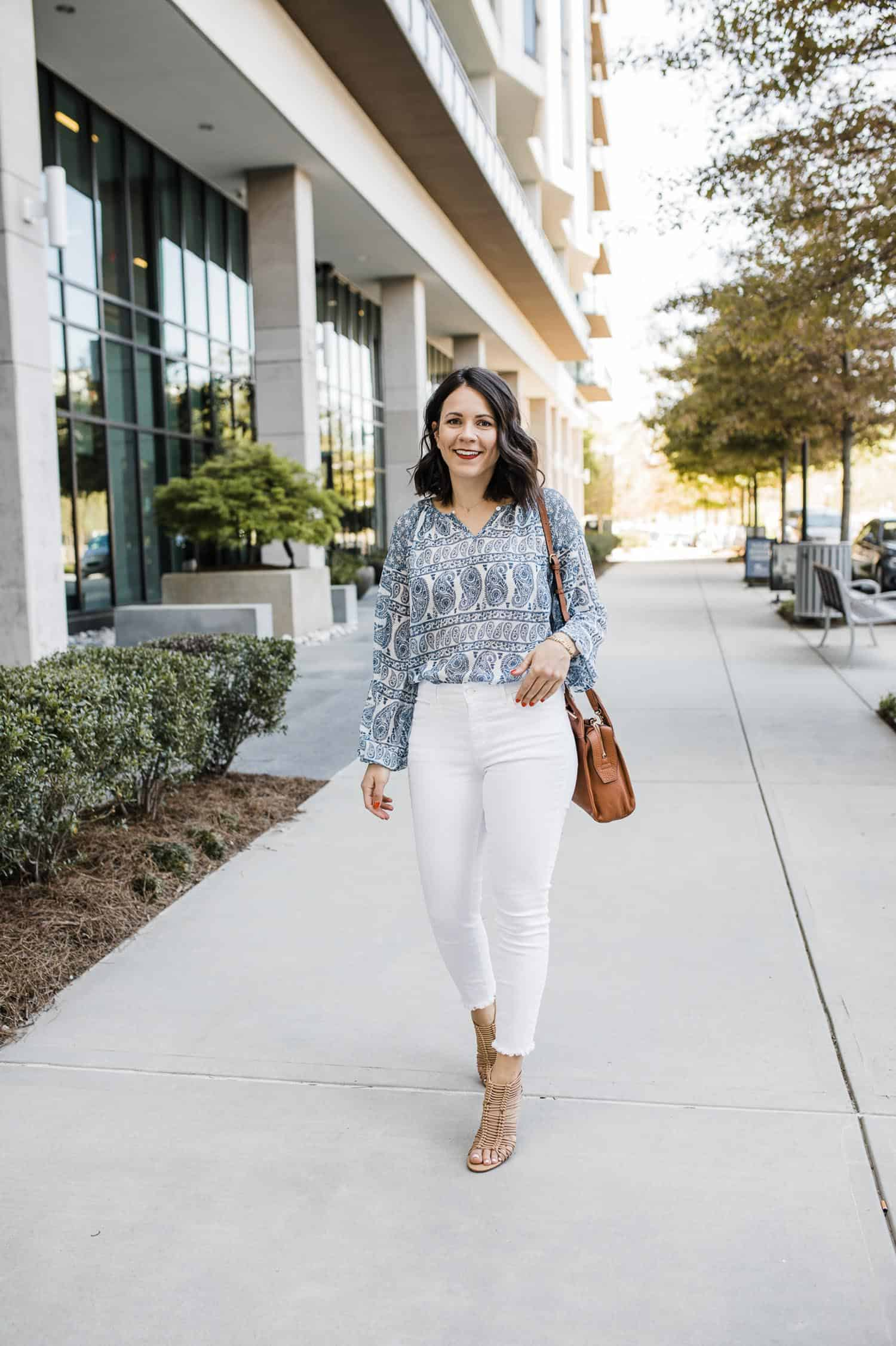 white jeans and blue paisley blouse