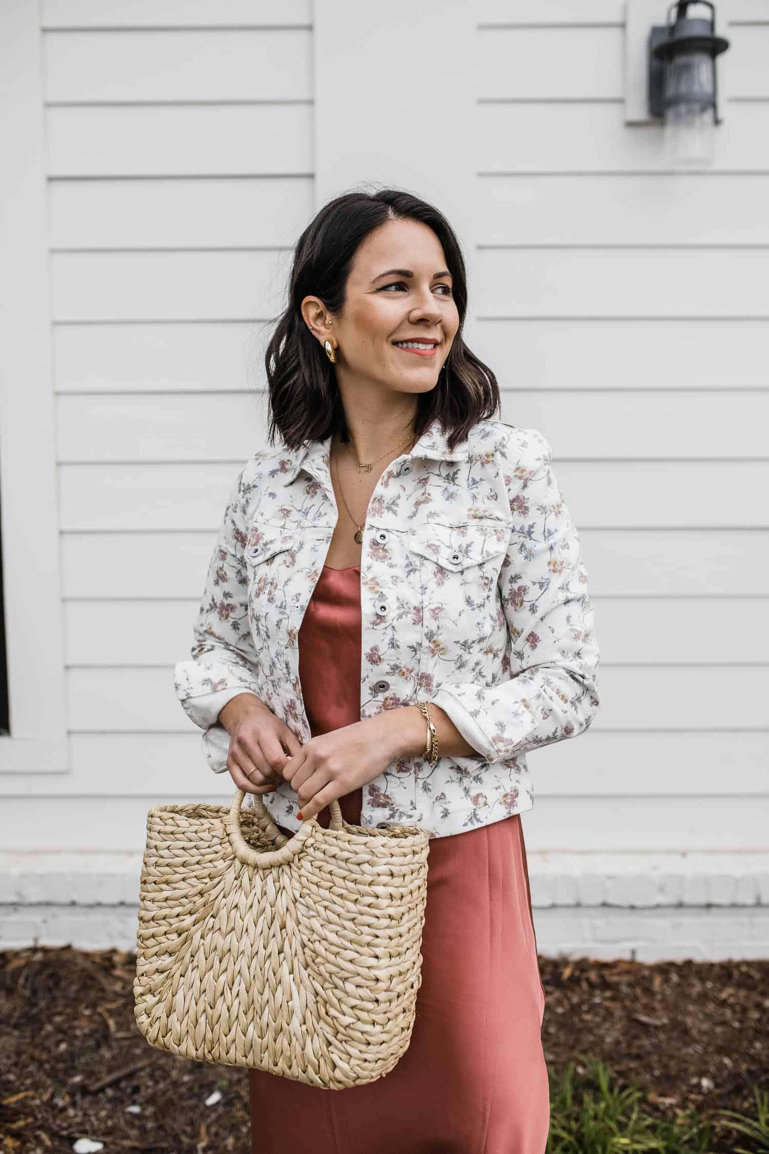 floral printed denim jacket and straw tote