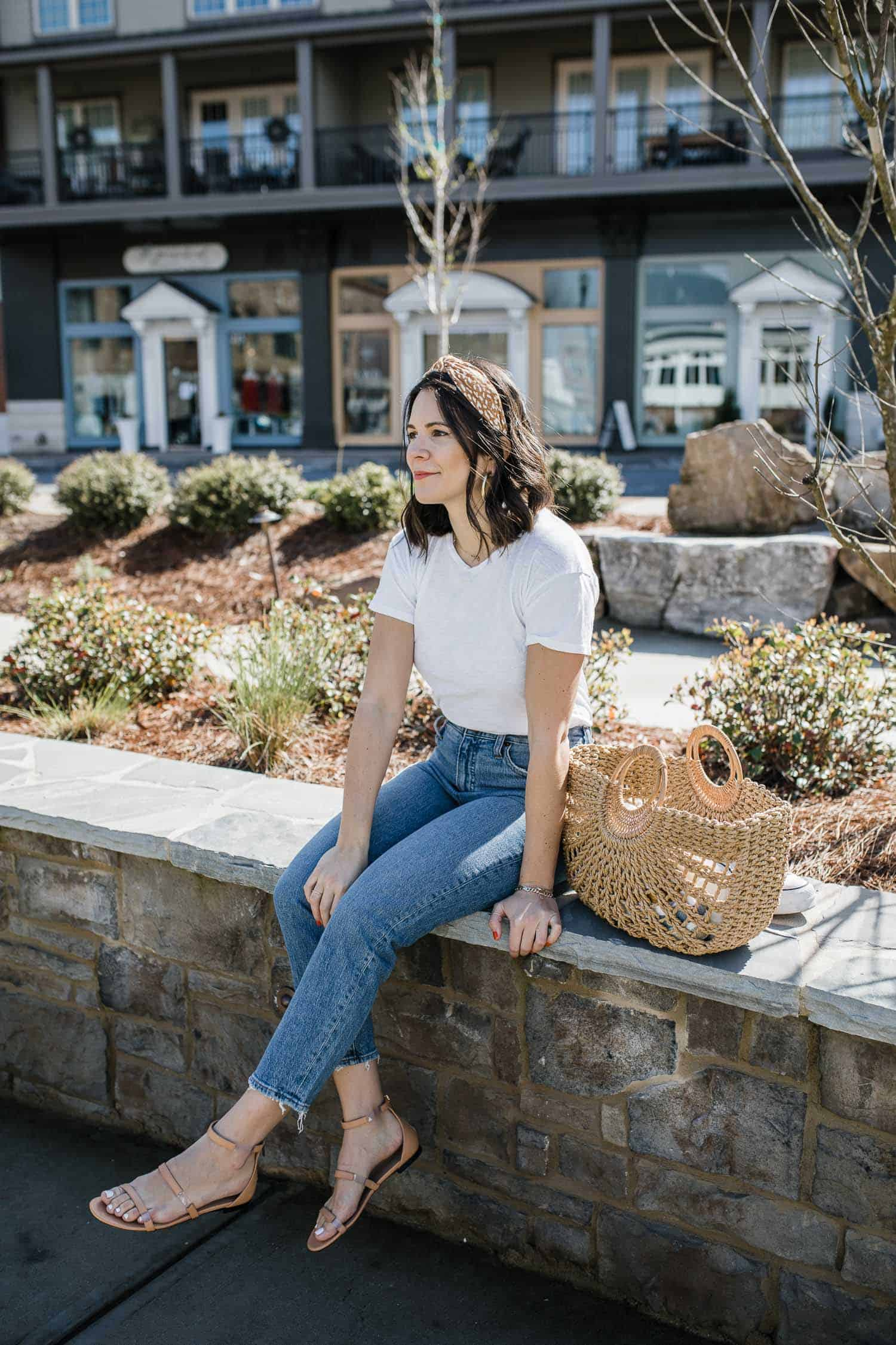 Jessica Camerata styles summer denim with a white tee and sandals