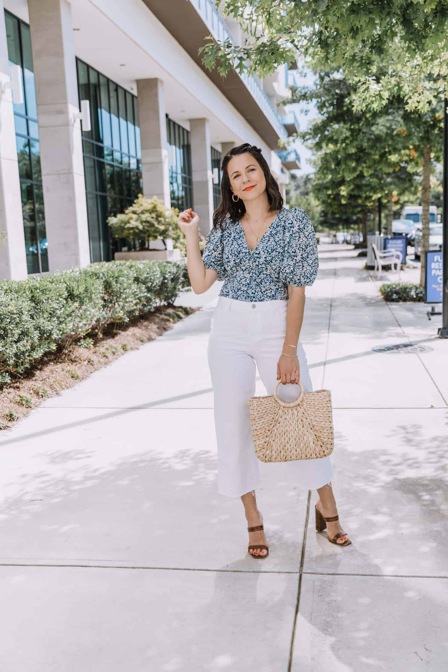white jeans with a blue floral blouse