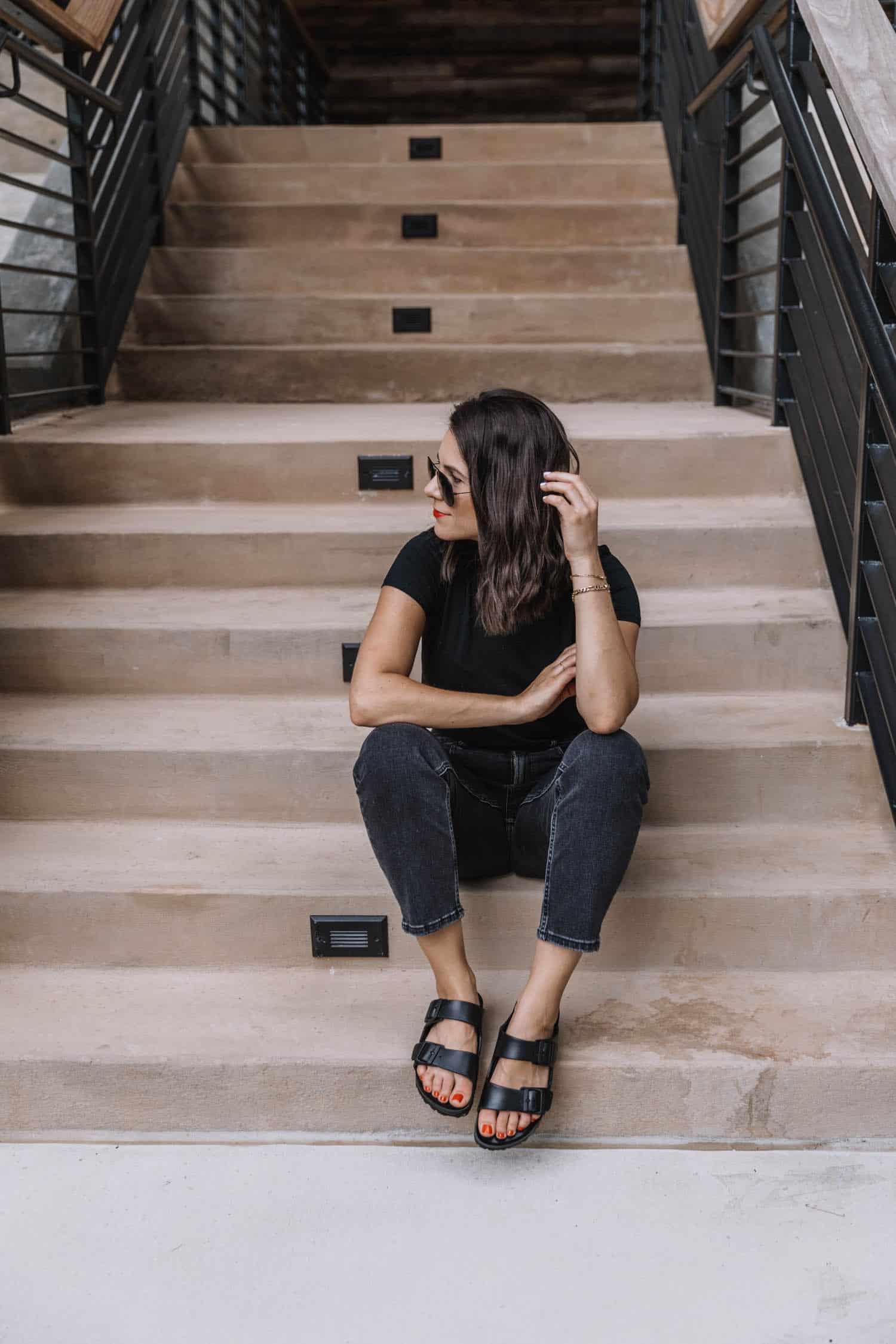 Jessica Camerata wears black jeans with black plastic birkenstocks