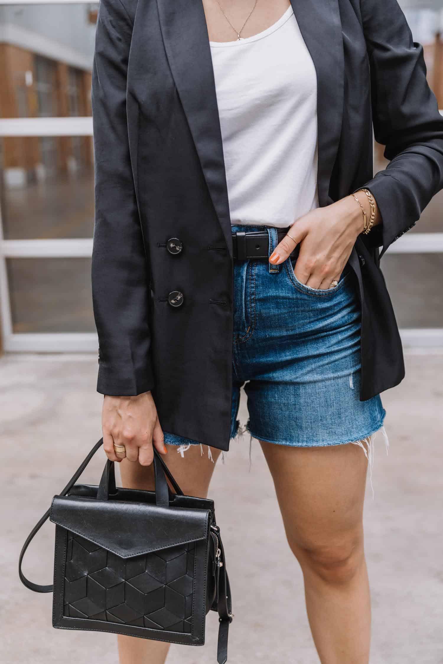 denim shorts with a black blazer