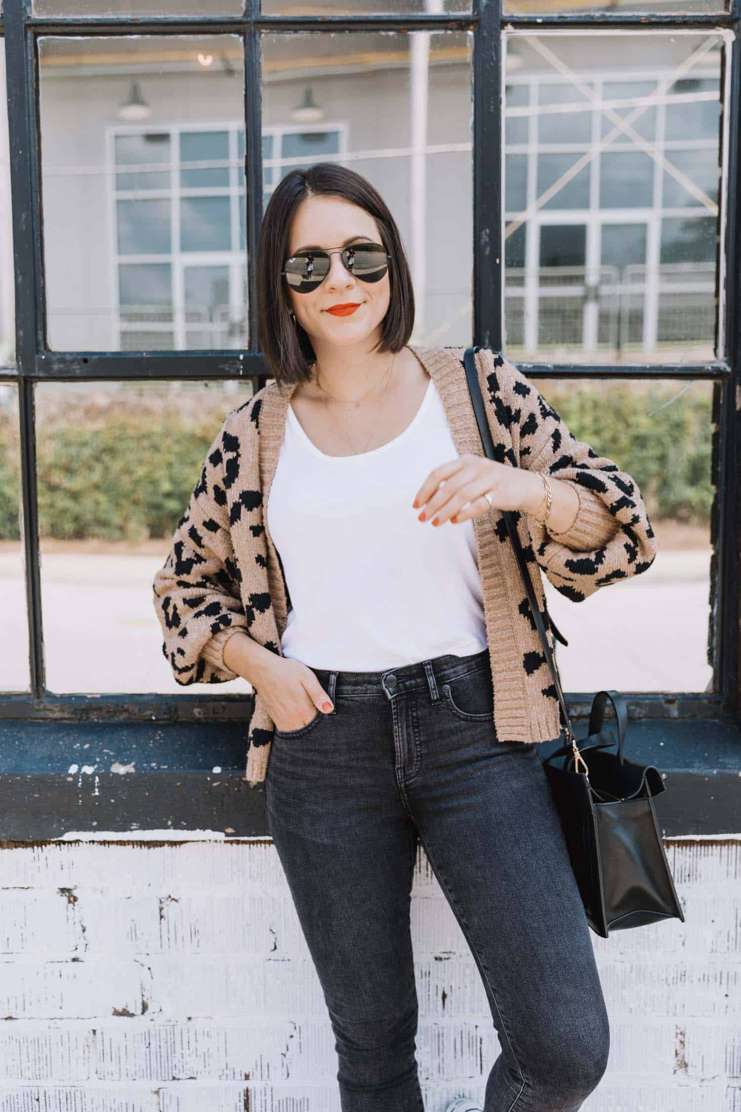 Jessica Camerata styles a leopard cardigan with black jeans for fall