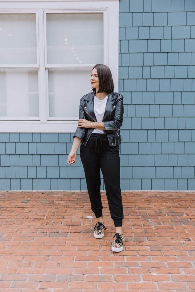 how to wear joggers leather jacket and leopard sneakers