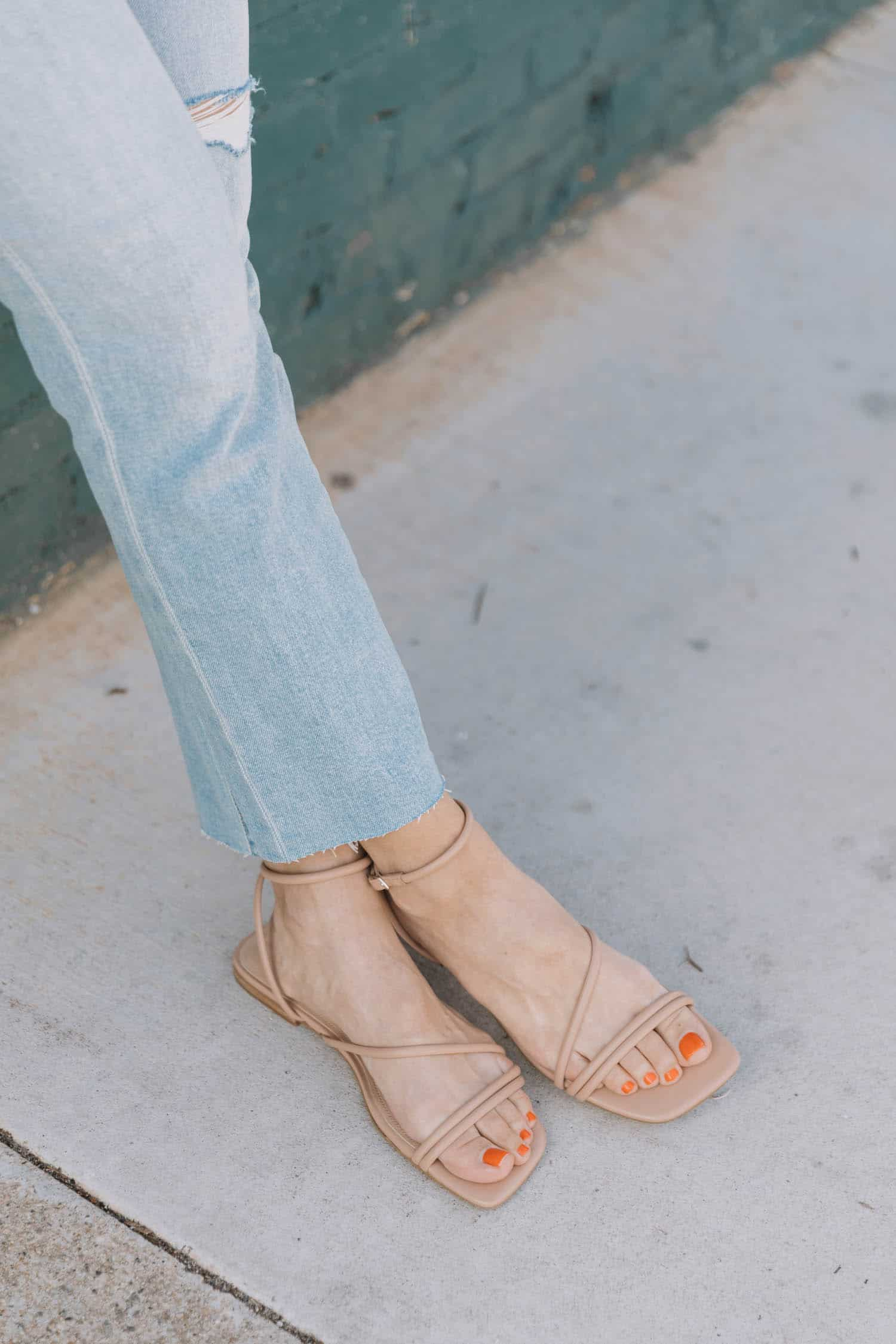 nude sandals and jeans